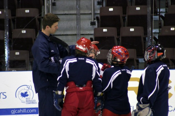 hockey coach with players
