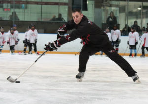 Jim Vitale demonstrating a backhand pass with reach and flexibility
