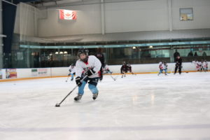 Crossing over prior to passing to give the puck more momentum